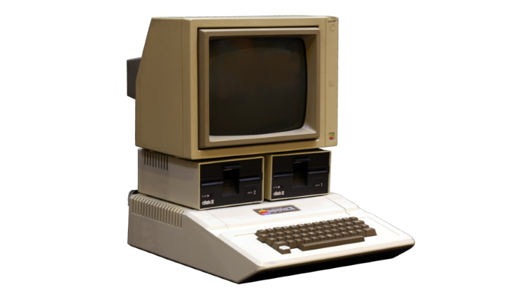 """Slide 4 of 14: The first mass-produced Apple computer was released four years before the IBM PC and it was a huge hit: it was one of the first computers with a colour display and arguably the first genuinely user-friendly perso<em></em>nal computer. it was made in various versions from 1977 to 1993, all of them following creator Steve Wozniak's edict that perso<em></em>nal computers should be """"small, reliable, co<em></em>nvenient to use and inexpensive"""". By the standards of the time the Apple II was all of those things, and thanks to Steve Jobs it was pretty good looking too. It sold at first to hobbyists and games players but soon found its way into businesses, helped by the first ever spreadsheet app, VisiCalc (1979)."""